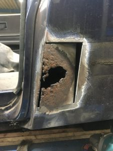 Rust hole on a car