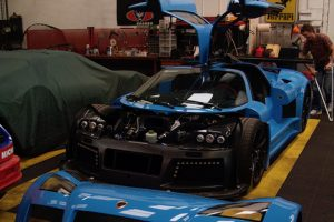 Gumpert Apollo S with front hood off the car.